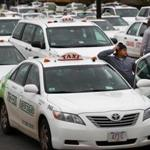 Cabdrivers waited in line for fares in Logan International Airport's taxi pool.