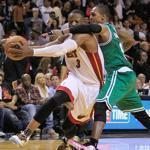 The Celtics' Rajon Rondo collars Heat guard Dwyane Wade in the fourth quarter, a play for which Rondo got a flagrant 1 foul.
