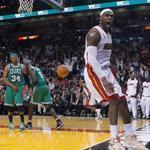 Heat star LeBron James (26 points) made some noise with this thunderous dunk, much to the dismay of Celtics Paul Pierce and Kevin Garnett.