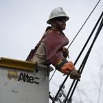 A utility worker helped in the repair effort on Tuesday in Needham.