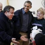 President Obama and New Jersey Governor Chris Christie talk with hurricane survivors at a New Jersey community center Wednesday.
