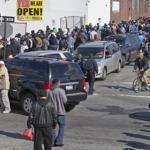 People lined up for free gas, both in cars and on foot, in the Jamaica neighborhood of Queens on Saturday.