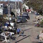 Garbage piled up on a street in the New Dorp neighborhood of Staten Island in the aftermath of Hurricane Sandy.