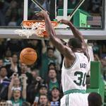 Forward Brandon Bass put the Celtics over the top, 97-92, with a dunk with 37 seconds left in overtime.