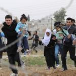 About 9,000 Syrian refugees crossed into Turkey in the past 24 hours, the UN refugee agency said on Friday.