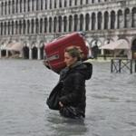 A tourist crossed flooded St. Mark's Square in Venice.