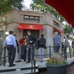 A former Boston Common bathroom retains its original look, but now displays the Earl of Sandwich chain name.