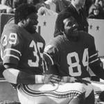 "October 3, 1976: Fullback Sam ""Bam"" Cunningham and wide receiver Daryl Stingley laugh with running back Andy Johnson as they celebrate a Patriot thrashing of the Oakland Raiders 48-17. ""No one has ever done this to one of my teams,"" said Raider coach John Madden after Oakland was pushed all over the field to the delight of a sellout crowd of 61,068. Cunningham rushed for 101 yards and caught passes for 94 more. Stingley caught two touchdown passes and rushed for 48 yards on two reverses."