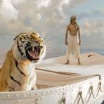 "Suraj Sharma as Pi Patel, adrift in a lifeboat with a tiger, and amid oceanic bioluminescence in Ang Lee's ""Life of Pi."""