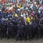 Police and civilians gathered for an M23 rally Wednesday in Goma, Congo, which the rebel group seized this week.