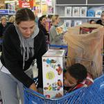 "Jolene Adams waited with son Elijah in a checkout line at Toys ""R"" Us in Framingham."