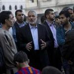 Ismail Haniyeh, prime minister of Gaza, talked with residents Sunday.
