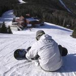 Jake Bartlett stepped into his snowboard at Sugarbush Mountain. Ski area operators have high hopes for the season.
