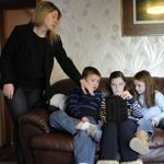 Debbie Currie watches what her children do on their electronic devices.