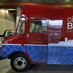 "Residents can pay parking tickets and tax bills, get a library card and dog license, even register to vote, at a van dubbed ""City Hall To Go."""