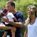 Tom Brady carried his son Benjamin as he walked off the practice field with wife, Gisele Bundchen at the end of a practice in August.
