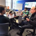 DataXu cofounder Bruce Journey (right) joined in a company brainstorming session.