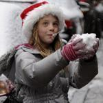 Ella Schweizer, 8, played with snow she scraped off of a car in the South End.