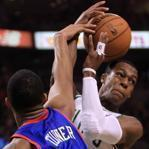 Rajon Rondo (7 points, 9 rebounds, 11 assists) takes a hit from the 76ers' Evan Turner.