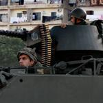 As the Syrian conflict has spilled into Lebanon, soldiers patrolled in Tripoli after clashes there killed at least 17 people.