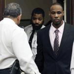 Dwayne Moore entered Suffolk Superior Court in Boston.