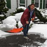 Foxborough resident Mary O'Dea had to shovel snow off her driveway during a fall storm.