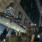 Shoppers walked past holiday decorations at Downtown Crossing in Boston Thursday.