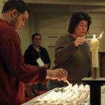 Jeremy Lurie and Paula Budlong lit candles during a service at the Church on the Hill.
