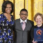 Romario Accime and Jill Medvedow received an award on behalf of the ICA from Michelle Obama at the White House.