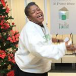 Lisa Marie Jenkins improvised a song of thanks to Cardinal Sean P. O'Malley at St. Francis House in downtown Boston Tuesday.