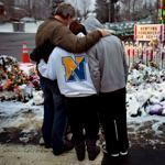A family at one of the expansive memorials in Newtown, Conn.