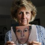 Colleen Krause held up a portrait of her husband, Stephen, who was killed in 2009 by an out-of-control Toyota Highlander.