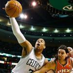 Jared Sullinger pulled in a rebound in front of Luis Scola of the Suns on Wednesday night.
