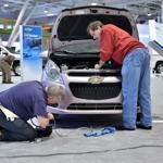Roy Myatt Jr. (left) and Mike Zuber prepared a 2013 Chevrolet Spark for the New England International Auto Show.