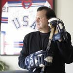 Mike Eruzione posed with his jersey in the background in 2010.
