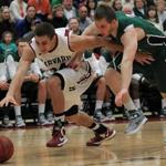 Harvard's Jonah Travis and Dartmouth's Connor Boehm play baseketball