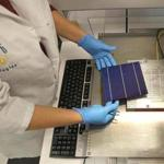 1366 Technologies technician Becky Allen handled a solar cell at the company's pilot plant in Bedford. 1366 was founded in 2007.