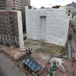Work stalled on the Filene's project in 2008 as the economy sputtered, leaving a crater at the construction site.