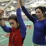 Globe writer Shira Springer (left) learned the finer points of pole vaulting from Olympic gold medalist Jenn Suhr.