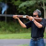 The White House on Saturday released a photo of President Obama firing a shotgun at Camp David in August.