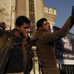 Mourners attend a commemoration ceremony Saturday for a protester who was killed Friday during a clash with Egyptian security forces near the presidential palace in Cairo.