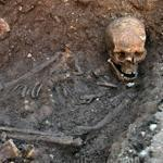 The skeleton of Richard III, with a cleaved skull and a curved spine, was entombed under a parking lot in the city of Leicester, England.