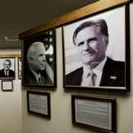 "Former Massachusetts governor Mitt Romney's portrait is the most recent addition to the ""They Also Ran Gallery,"" above a bank lobby in Norton, Kan."