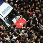 Protesters surrounded an ambulance carrying the body of Chokri Belaid, who was killed outside his home Wednesday.