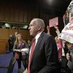 Protesters disrupted the Senate hearing on John O. Brennan's nomination as CIA chief.