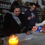 No power at the Liquor Barn in Buzzards Bay meant assistant manager Nancy Smith and manager Phil Malouin had to work by candlelight.
