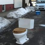 A toilet marked a continued claim on a parking space on East Fourth Street in South Boston.
