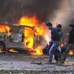 At least three car bombs, including one near the downtown headquarters of President Bashar Assad's ruling party, exploded in the Syrian capital on Thursday.