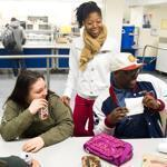 Clarice Maloney, 21, and several fellow students gathered in the cafeteria at Boston Day and Evening Academy.