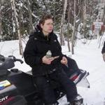 Nicholas Joy, 17, sat on a snowmobile after being found on a trail off the western side of Sugarloaf Mountain on Tuesday.
